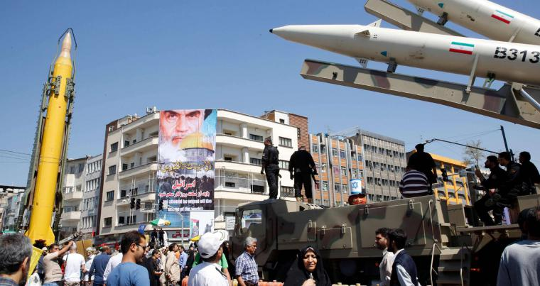 A Shahab-3 long range missile (L) and Zolfaghar missiles (R) are displayed during a rally  in Tehran. (AFP)