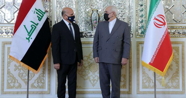 Iranian foreign Minister Mohammad Javad Zarif (R) welcomes his Iraqi counterpart Fuad Hussein at the ministry headquarters in the capital Tehran. (AP)