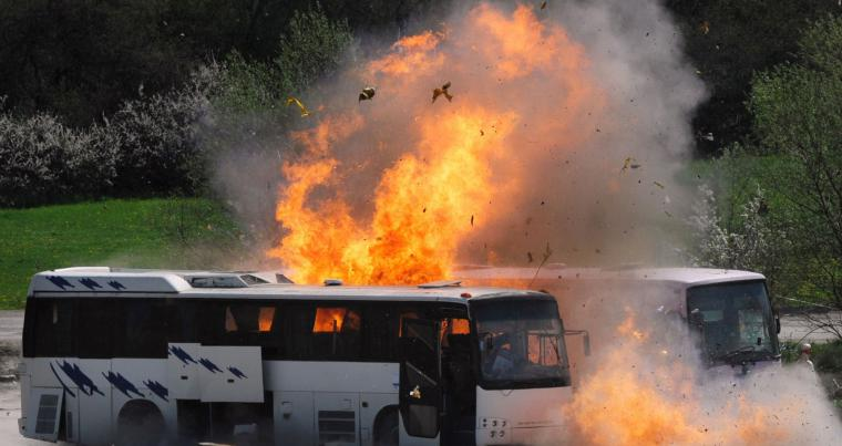Two buses are exploded as investigators re-enact the July 2012 Burgas airport bus bombing that killed five Israeli tourists near the town of Ihtiman in Bulgaria. (AFP)