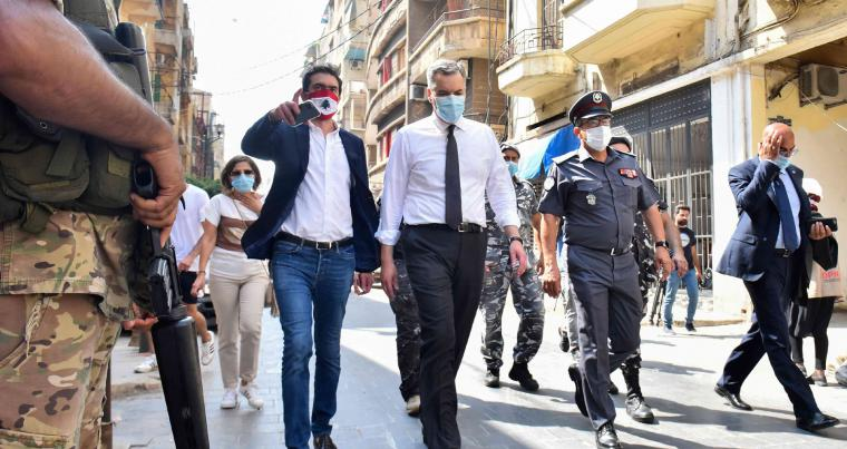 Lebanon's newly-appointed Prime Minister Mustapha Adib (C) visits Beirut's badly-hit Gemmayzeh neighbourhood, on August 31. (AFP)
