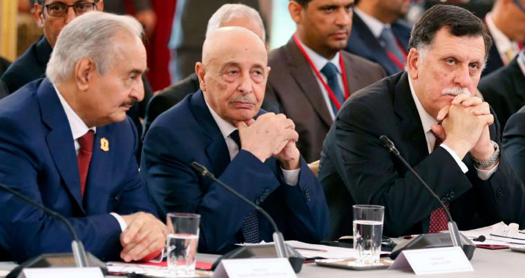 A 2018 file picture shows Libyan LNA commander Field Marshal Khalifa Haftar and Parliament Speaker Aguila Saleh Issa, next to GNA's Prime Minister Fayez al-Sarraj, during a conference on Libya, in Paris. AFP