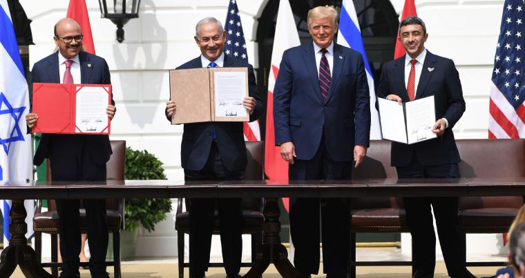 (L-R) Bahraini FM Abdullatif al-Zayani, Israeli PM Binyamin Netanyahu, US President Donald Trump, and UAE FM Abdullah bin Zayed al-Nahyan participate in the signing of the Abraham Accords at the White House in Washington, September 15. (AFP)