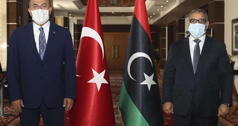 Turkish Foreign Minister Mevlut Cavusoglu, left, and Khalid Al-Mishri, head of the Libyan High Council of State, hold talks, in Tripoli, Libya, last month. (AP)