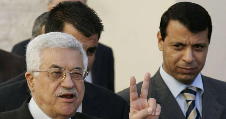 A 2006 file photo shows Palestinian Authority President Mahmoud Abbas, left, flashes the V sign as then Fatah official, Mohammed Dahlan, looks on in the West Bank town of Ramallah. (AFP)