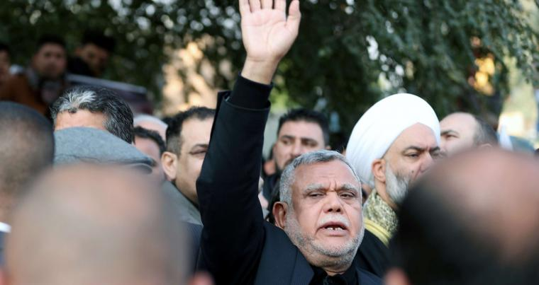 A file photo shows Iraqi militia commander Hadi al-Amiri attending the funeral of the Iranian Major-General Qassem Soleimani and the Iraqi militia commander Abu Mahdi al-Muhandis, January 4, in Baghdad. (REUTERS)