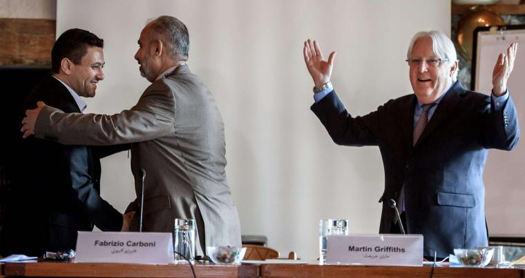 Head of the Houthi prisoner exchange committee Abdulkader al-Murtada (L) shakes hands with Head of the Yemeni government delegation Hadi Haig (2nd L) next to UN Special Envoy Martin Griffiths at the end of a meeting on September 27, in Glion, Switzerland. (AFP)