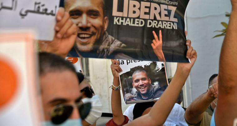 Algerian journalists rally in Algiers, August 31, to demand the release of their colleague Khaled Drareni, who was sentenced earlier this month to three years in jail. (AFP)