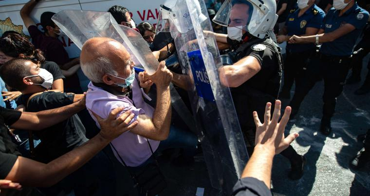 Protesters clash with Turkish police in Istanbul after the death in prison of Turkish lawyer Ebru Timtik, on August 28. (AFP)