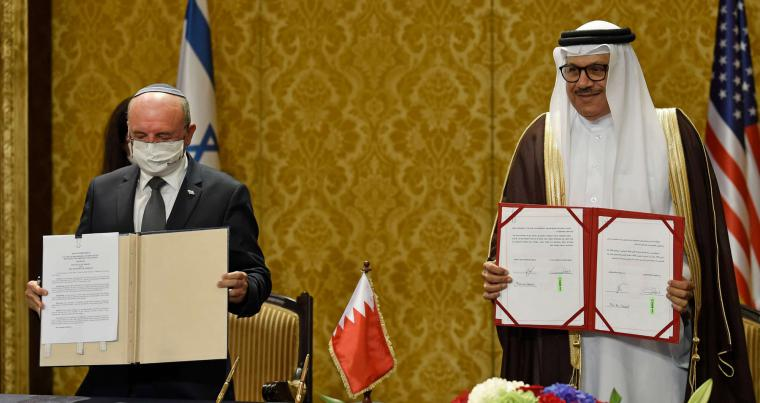Bahraini Foreign Minister Abdullatif bin Rashid Al-Zayani (R) and head of the Israeli delegation National Security Adviser Meir Ben Shabbat show signed agreements during a ceremony in Bahrain's capital Manama, on October 18. (AFP)