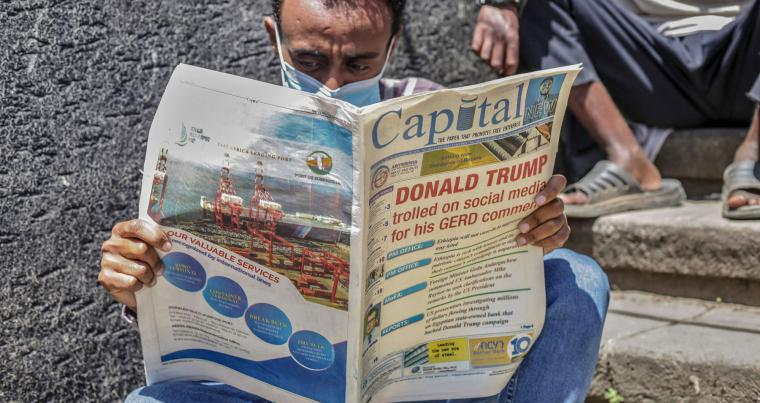 A man in Addis Ababa reads an Ethiopian newspaper featuring remarks by US President Trump regarding Ethiopia's $5 billion Great Ethiopian Renaissance Dam (GERD) hydroelectric dam, on October 26.  AFP