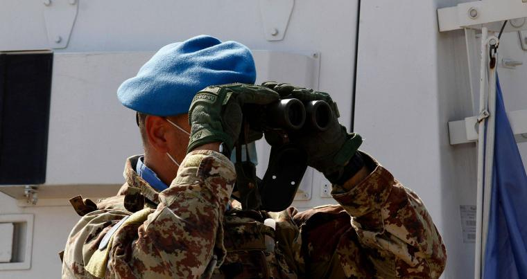A soldier with the UN Interim Force in Lebanon (UNIFIL) monitors the area near the southern Lebanese border town of Naqura, October 29, during the second round of talks between Lebanon and Israel at a UN base. (AFP)