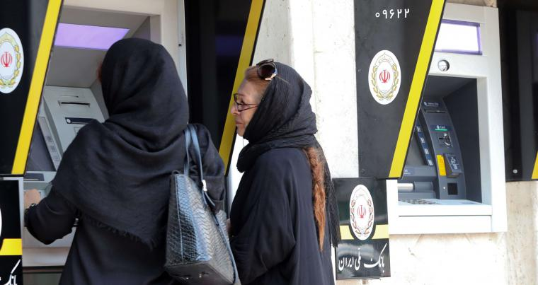 Iranian women use automated teller machines (ATM) in Tehran. (AP)