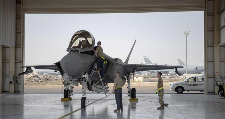 An August 2020 file picture shows an F-35 fighter jet pilot and crew preparing for a mission at Al-Dhafra Air Base in the United Arab Emirates. (AP)