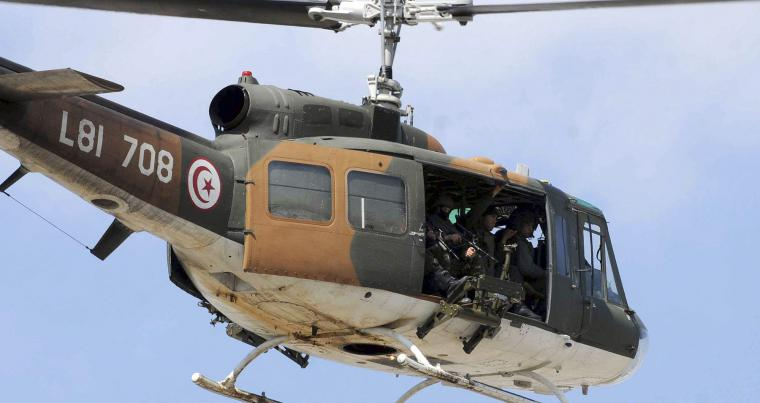 A Tunisian army helicopter flies over Tunis during an anti-terrorism operation in 2015. (AP)