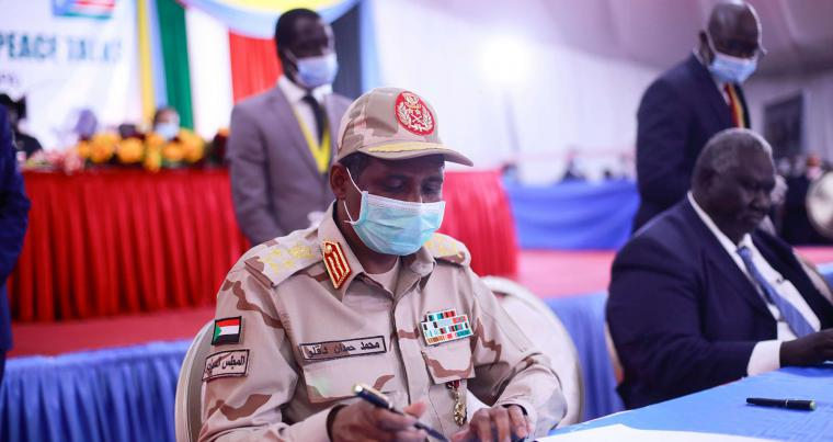 A file picture shows Sudanese paramilitary commander Mohamed Hamdan Daglo signing the peace deal document between the government and the rebel groups in Juba, South Sudan, on August 31. (AFP)