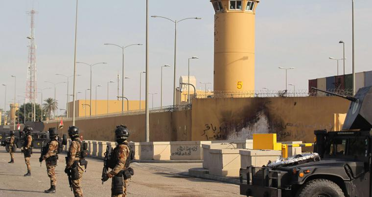 A file picture shows Iraqi security forces standing guard in front of the US embassy in Baghdad's Green Zone. (AFP)