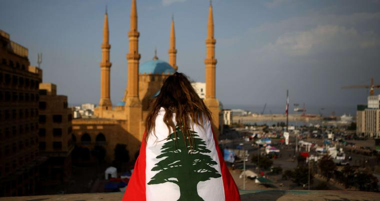 A Lebanese anti-government protester sits on the rooftop of 'The Egg' buidling overlooking the Mohammed al-Amin mosque and the Martyrs square in Beirut, in November 2019. (AFP)