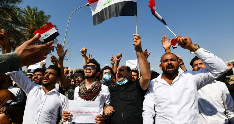 Iraqi demonstrators in Nasiriyah on October 28, 2020, demand a total overhaul of Iraq's political system. (AFP)