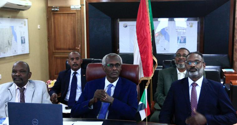Sudan's Minister of Irrigation and Water Resources Yasser Abbas (C) participates in a videoconference with his Egyptian and Ethiopian counterparts in Khartoum on November 1, 2020. (AFP)