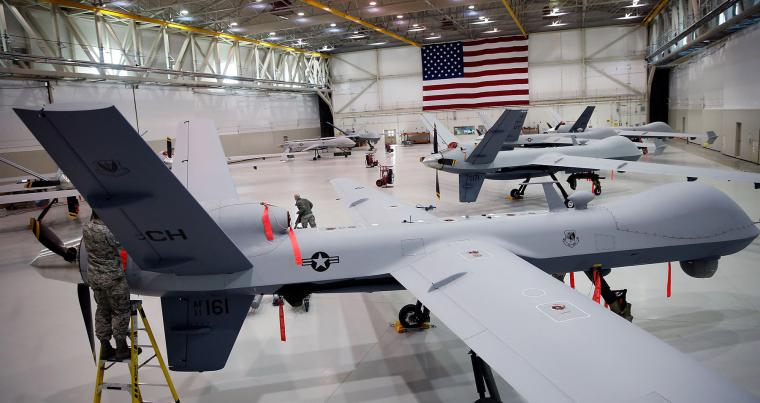 Remotely piloted aircraft MQ-9 Reapers and an MQ-1B Predator are parked in a hanger at Creech Air Force Base in Indian Springs, Nevada. (AFP)