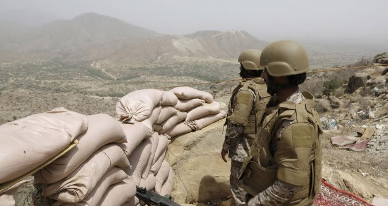 A 2015 file picture shows Saudi soldiers standing guard from behind a sandbag barricade at the Saudi border with Yemen in Jazan. (AP)