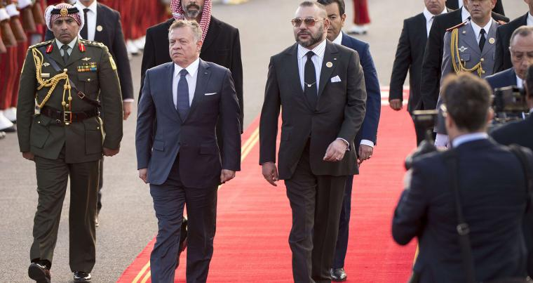 A file picture shows Moroccan King Mohamed VI (C-R) and Jordanian King Abdullah II (C-L) attending a welcome ceremony in Rabat on March 22 , 2017. (AFP)