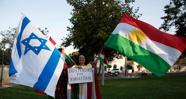 Members of the Kurdish Jewish community hold Kurdish and Israeli flags during a 2017 demonstration in Jerusalem in support of the referendum on independence in Iraq's autonomous Kurdish region. (AFP)