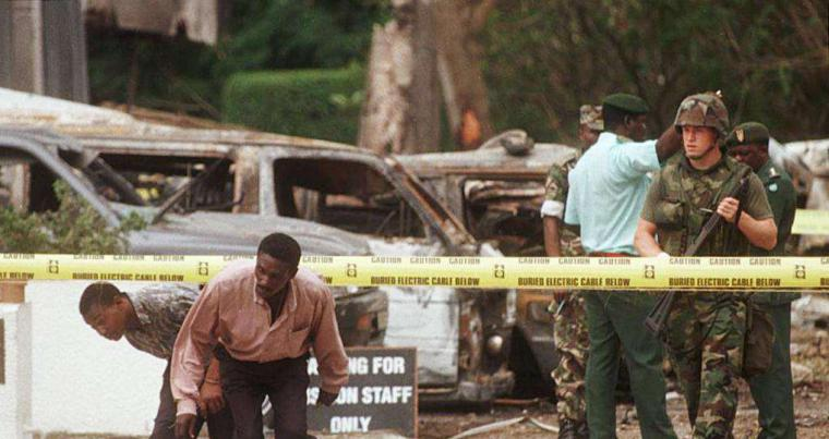 A 1998 file picture shows a US soldier standing guard in front of the US embassy in Dar es Salaam, Tanzania, the site of an Al Qaeda bomb blast. (AFP)