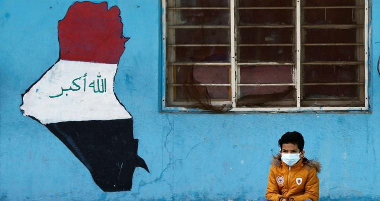 A student wearing a protective face mask, amid the outbreak of the coronavirus disease (COVID-19), sits at a school in Baghdad, Iraq December 14, 2020. (REUTERS)