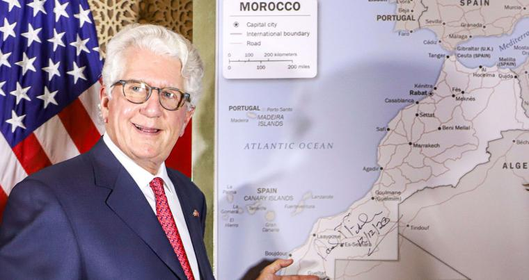 David T. Fischer, US Ambassador to Morocco, standing before a US State Department-authorised map of Morocco recognising the kingdom's soverignty over the Western Sahara . (AFP)