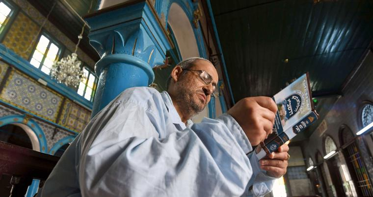 Tunisian Rabbi Daoud reads the torah at the Ghriba Synagogue on the Tunisian island of Djerba. (AFP)