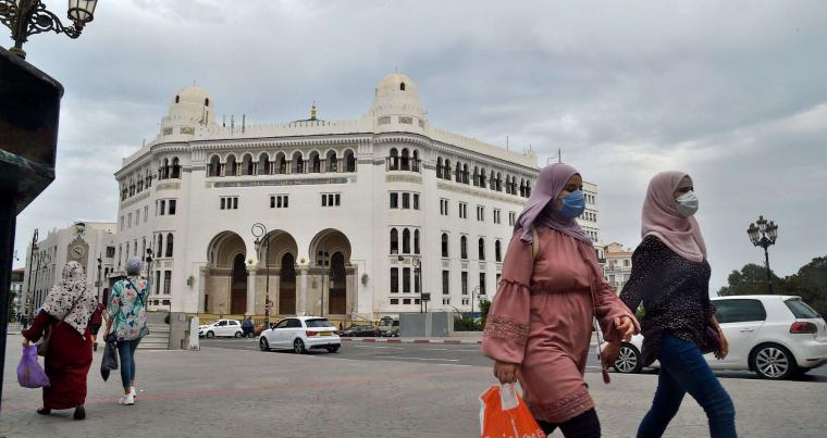 Algerian women wearing protective masks walk in the centre of the capital Algiers. (AFP)