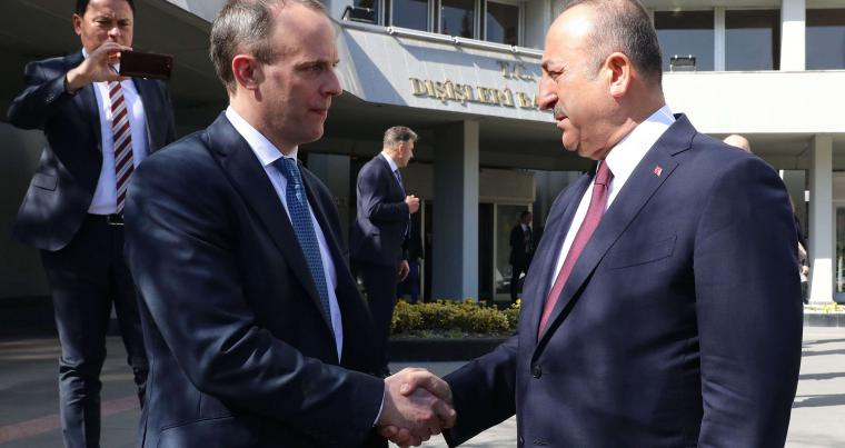 A file picture shows Turkish Foreign Minister Mevlut Cavusoglu (R) meeting with British Foreign Secretary Dominic Raab, in Ankara, Turkey, on March 3, 2020. (AFP)
