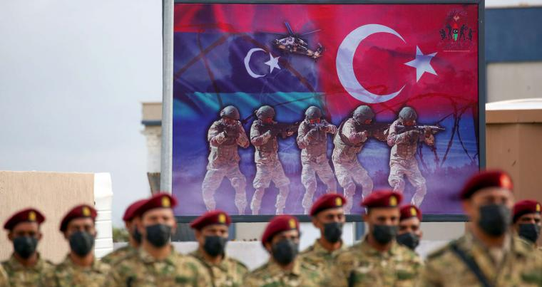 Libyan military graduates loyal to the GNA take part in a parade marking their graduation, a result of a military training agreement with Turkey,  in the city of Tajoura, south-east of Tripoli on November 21, 2020. (AFP)