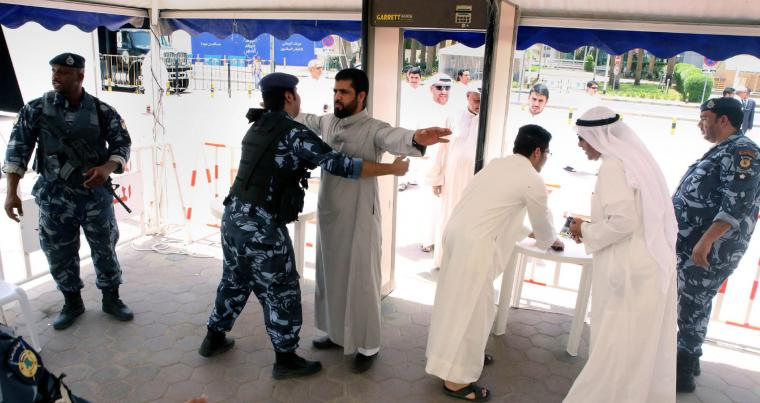A file picture shows Kuwaiti worshippers being searched by security members outside the Sunni Grand Mosque in Kuwait City. AFP