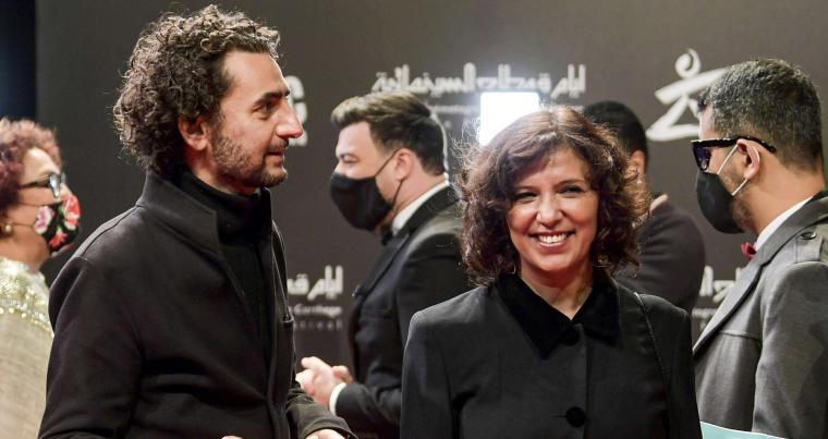 Tunisian film director Kaouther Ben Hania (R) at the opening ceremony of the 31st edition of the Carthage Film Days (JCC) film festival at the Opera House in Tunis on December 18, 2020. (AFP)