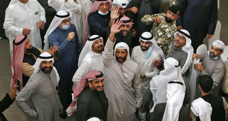 Kuwaiti MP Marzouq al-Ghanim supporters celebrate his victory for the Parliament speaker election, December 15, 2020. (AFP)