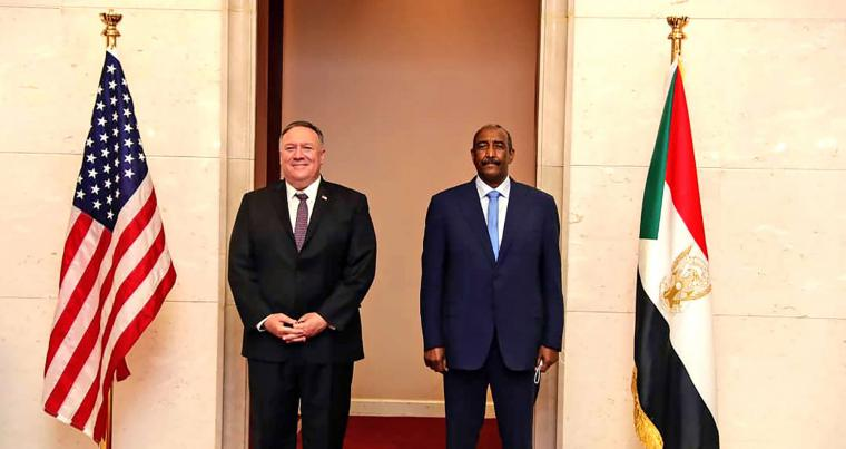 US Secretary of State Mike Pompeo stands with Sudanese General Abdel-Fattah al-Burhan, head of the ruling sovereign council, in Khartoum, Sudan, last August. (AFP)