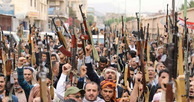 Houthi followers wave up their weapons during a gathering in Sanaa, Yemen. (REUTERS)