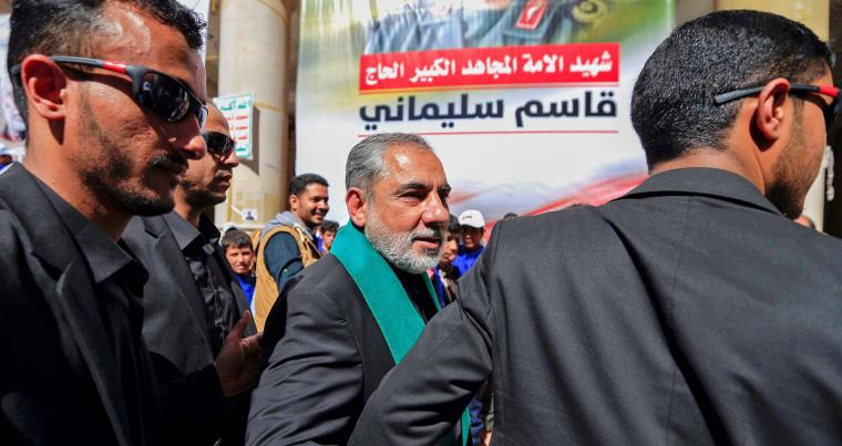 Iranian ambassador to the Houthis Hassan Eyrlo attends a vigil in the Yemeni capital of Sana'a, on January 2, 2021, to mark the one-year anniversary the US killing of Iranian major general Qassem Soleimani. (AFP)