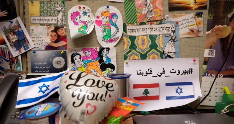 Images and objects are displayed in the office where team members of the Arabic-language social media unit work, at the Israeli foreign ministry in Jerusalem December 1, 2020. Picture taken December 1, 2020. (REUTERS)
