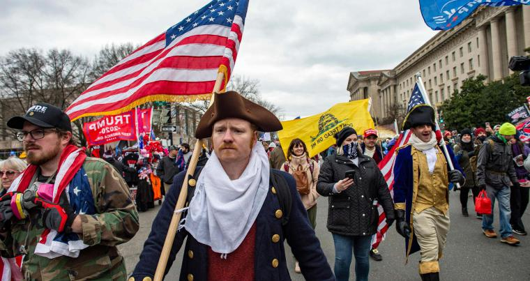 Supporters of US President Donald Trump march through the streets of the city as they make their way to the Capitol Building in Washington, on January 6, 2021. (AFP)
