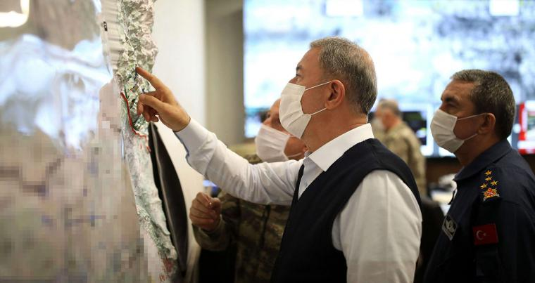 "A June 17, 2020 file picture shows the Turkish Defence Minister Hulusi Akar looking at a map with members of the Turkish Armed Forces Command  in Ankara during the military operation dubbed ""Claw-Tiger."" (AP)"