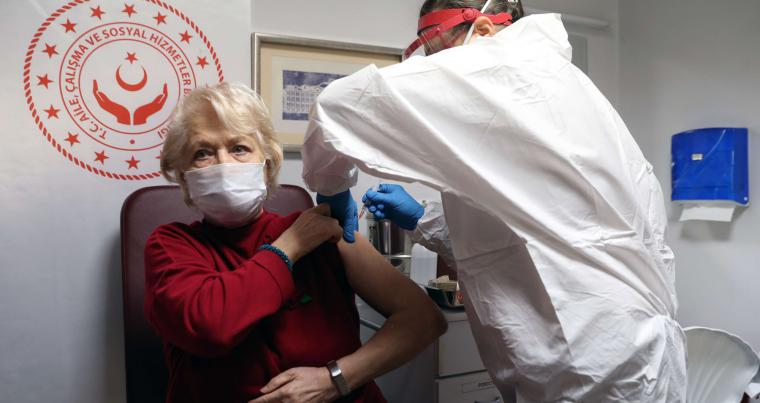 An elderly woman receives an injection of the CoronaVac vaccine at a nursing home in Ankara, on January 19, 2021, amid the COVID-19 pandemic caused by the novel coronavirus. (AFP)