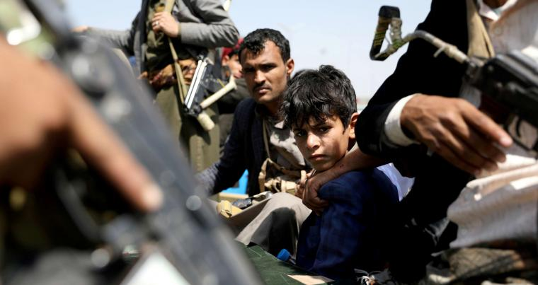 A boy rides with Houthi followers on the back of a patrol truck during the funeral of Houthi fighters killed during battles against government forces, in Sanaa,. (REUTERS)