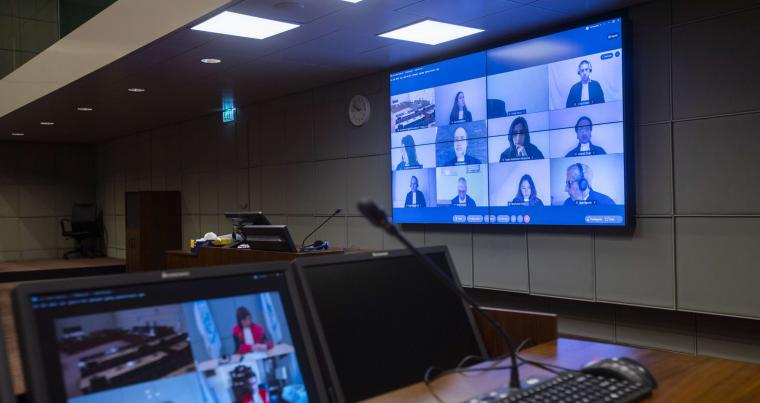 Additional judges, the prosecution and defense lawyers are seen on screens via video link due to COVID-19 measures, at the start of the session of the United Nations-backed Lebanon Tribunal, in Leidschendam, Netherlands, last December. AFP