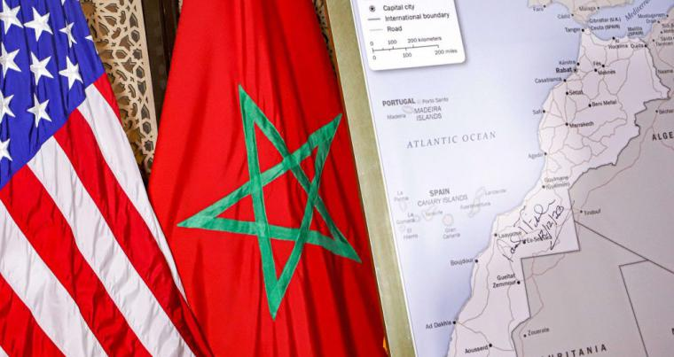 L to R: US and Moroccan flags next to a US State Department-authorised map of Morocco recognising the internationally-disputed territory of the Western Sahara. (AFP)