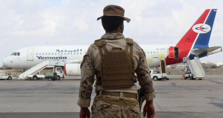A member of the military security personnel stands guard on the tarmac of the airport in Yemen's southern city of Aden. (AFP)