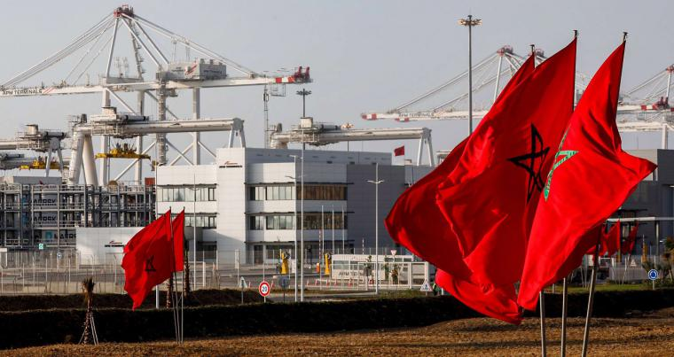 Moroccan flags flutter near container cranes at the new terminals of the Tanger Med port in the northern city of Tangiers on the Strait of Gibraltar. (AFP)