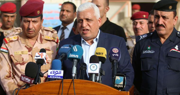 Falah al-Fayadh, Iraqi national security adviser and chief of the Hashed al-Shaabi (Popular Mobilisation Forces), gives a press conference at the organisation's command headquarters in the southern city of Basra on March 7, 2018. (AFP)